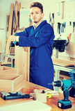 Man measuring boards for furniture at workshop Stock Photography