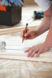 Man measuring boards during renovation Royalty Free Stock Photography