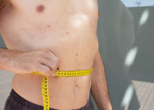 Man measuring body contouring. Body of a man measuring contour and body fat Stock Photos