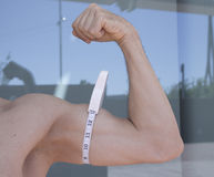 Man measuring body contouring. Body of a man measuring contour and body fat royalty free stock photo