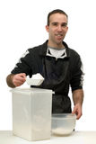 Man Measuring Flour Royalty Free Stock Photography