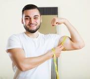 Man measuring his bicep Stock Image