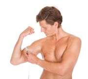fit man measuring his muscle biceps stock image image of exercising building 36033575. Black Bedroom Furniture Sets. Home Design Ideas