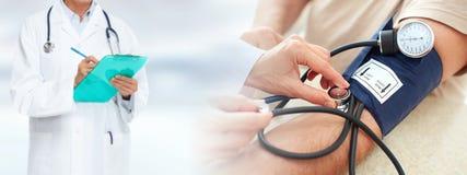 Man measuring his blood pressure. Stock Images