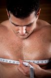 Man measuring his chest Stock Image