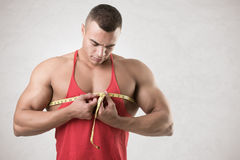 Man Measuring His Chest Stock Photo