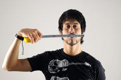 Man measuring his face Royalty Free Stock Photos