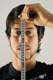 Man measuring his face Stock Photo