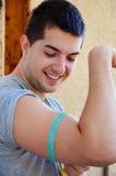 Man measuring his muscle biceps stock image