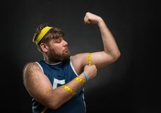 Man measuring his muscle Stock Photography