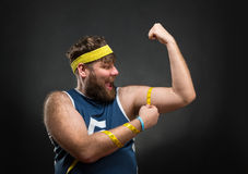 Man measuring his muscle Royalty Free Stock Photo