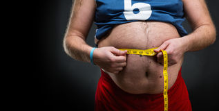 Man measuring his waist Royalty Free Stock Photo