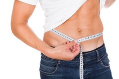 Man measuring his waistline Royalty Free Stock Images
