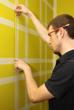 Man measuring interior wall Royalty Free Stock Photography