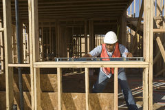 Man Measuring Level Of A Wooden Beam Stock Image