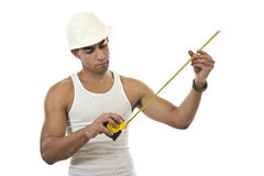 Man with a measuring tape Royalty Free Stock Photo