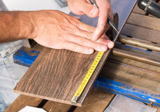 Man measuring a tile piece Stock Images
