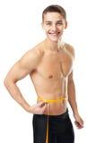 Man measuring waist Stock Photography