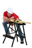 Man measuring wood Royalty Free Stock Photo
