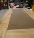 Man measuring woodworking project Stock Photos