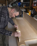 Man measuring woodworking project Stock Image