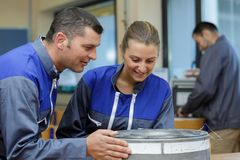 Man mechanic and woman repair something royalty free stock photography