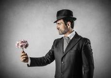 Man med blommor Arkivfoto