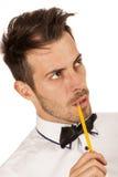 Man med blyertspennan Fotografering för Bildbyråer