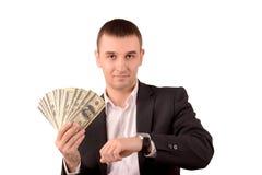 Man med dollar och klockan fotografering för bildbyråer
