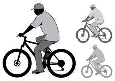 Man med en cykel Fotografering för Bildbyråer