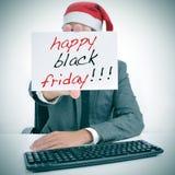 Man med en skylt med texten lyckliga svarta fredag Arkivfoton