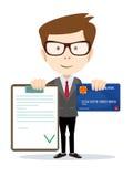 Man med ett godkänt avtal och kreditkortar Arkivbilder