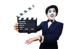 Man med filmclapperen Arkivfoto