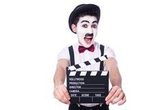 Man med filmclapperen Arkivbild