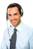 man med hörlurar med mikrofonarbete som en appellmittoperatör Royaltyfria Bilder