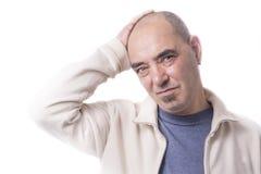 Man med huvudvärk Arkivfoto