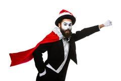 Man med julhatten och jultomten säck Arkivfoton