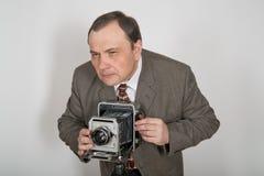 Man med kameran Fotografering för Bildbyråer