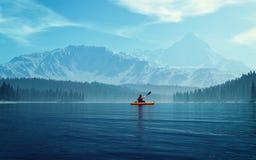 Man med kanoten på sjön Royaltyfria Foton