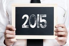 Man med 2015 ombord Arkivbild