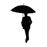 Man med paraplysvartkonturn Fotografering för Bildbyråer