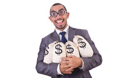 Man med pengarsäckar Arkivfoto