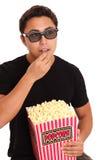 Man med popcornhinken och exponeringsglas 3D Arkivfoton