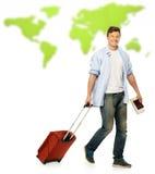Man med resväskan och översikten arkivfoton