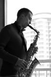 Man med saxofonen Royaltyfria Foton