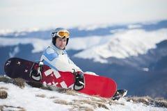 Man med snowboarden Fotografering för Bildbyråer