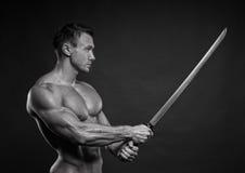 Man med svärd Fotografering för Bildbyråer