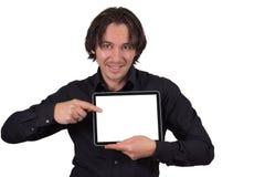 Man med tabletdatoren. Fotografering för Bildbyråer