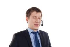 Man med telefonhörlurar med mikrofon på huvudet Arkivfoton