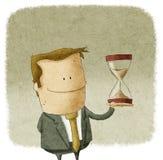 Man med timglas i hand stock illustrationer